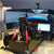 James Hinchcliffe and Sebastian Saavedra help tune a SimXperience Stage V Racing Simulator